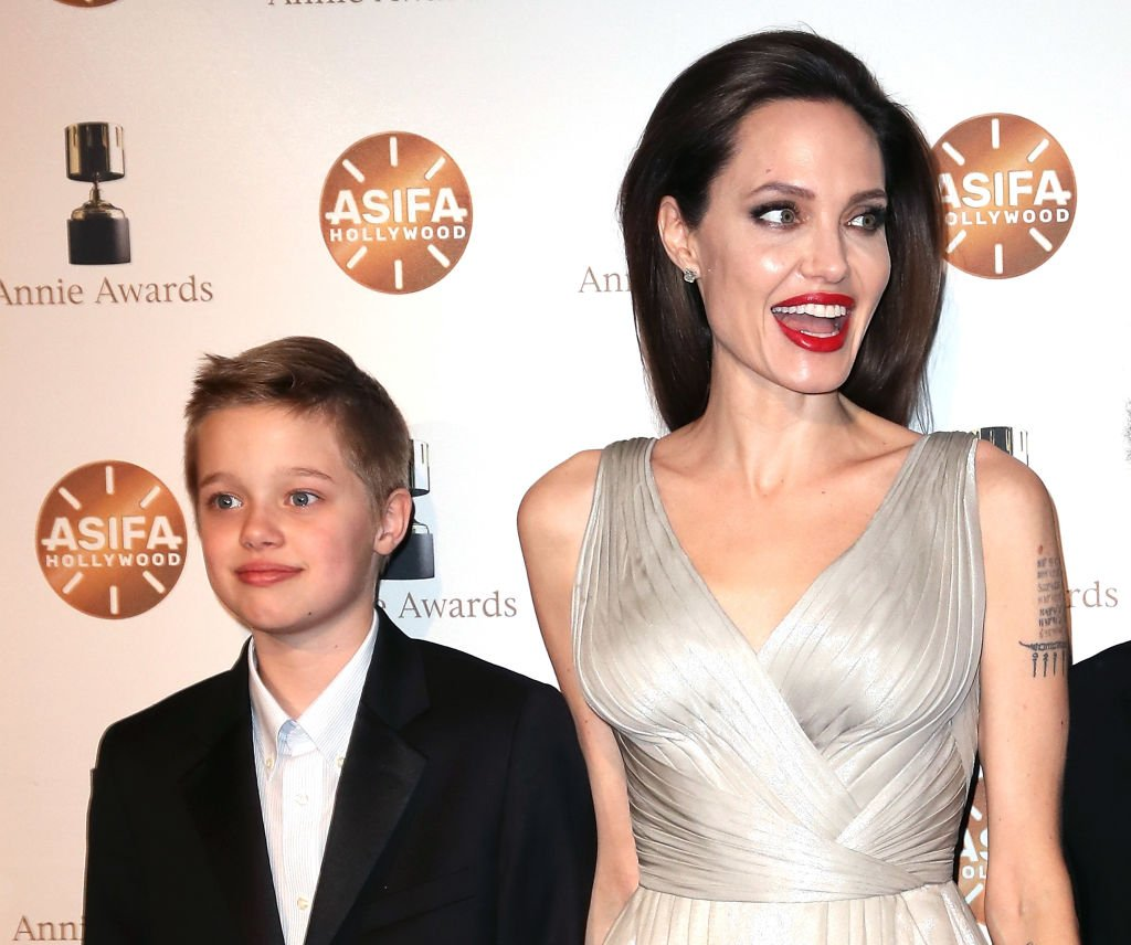 Shiloh Nouvel Jolie-Pitt (L) and mother actress Angelina Jolie attend the 45th Annual Annie Awards at Royce Hall on February 3, 2018 | Photo: Getty Images