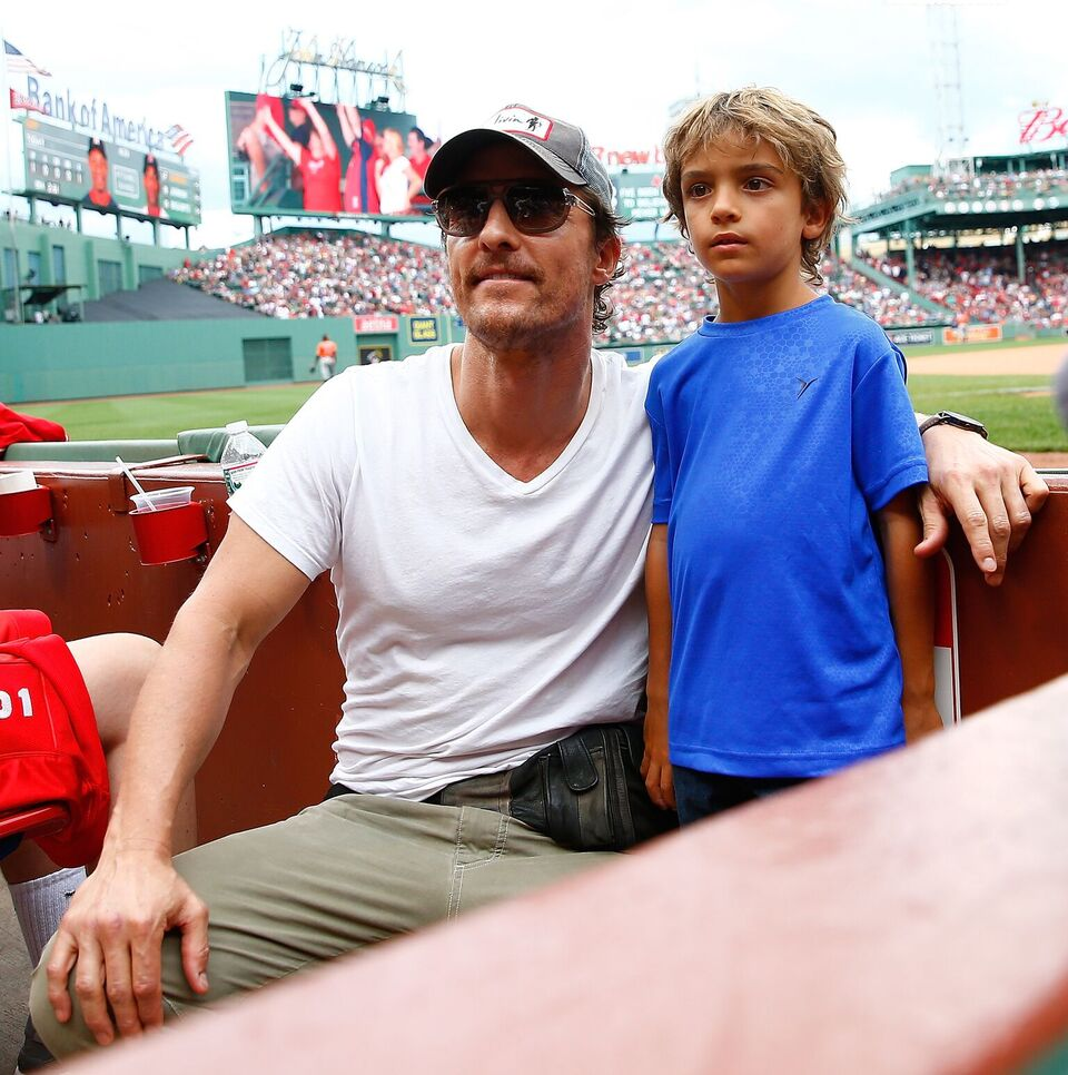 Matthew McConaughey and his son Levi pose for a photo during the game between the Boston Red Sox and the Houston Astros during the game at Fenway Park on August 17, 2014 in Boston, Massachusetts. | Source: Getty Images