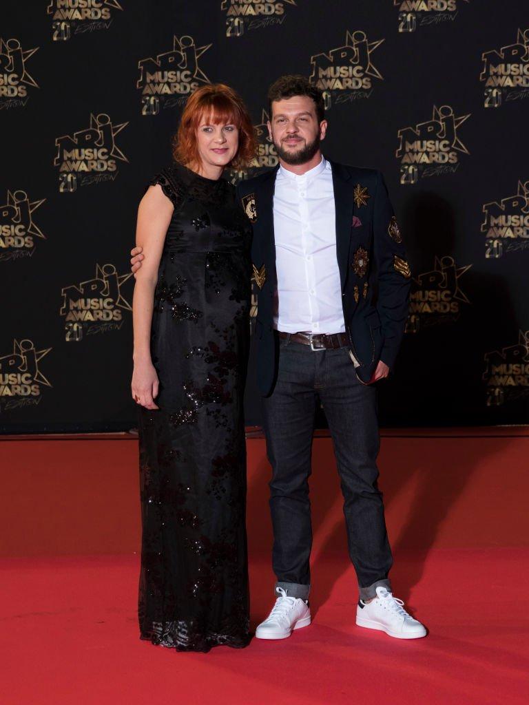 Claudio Capeo et sa femme assistent aux 20èmes NRJ Music Awards à Cannes. | Getty Images
