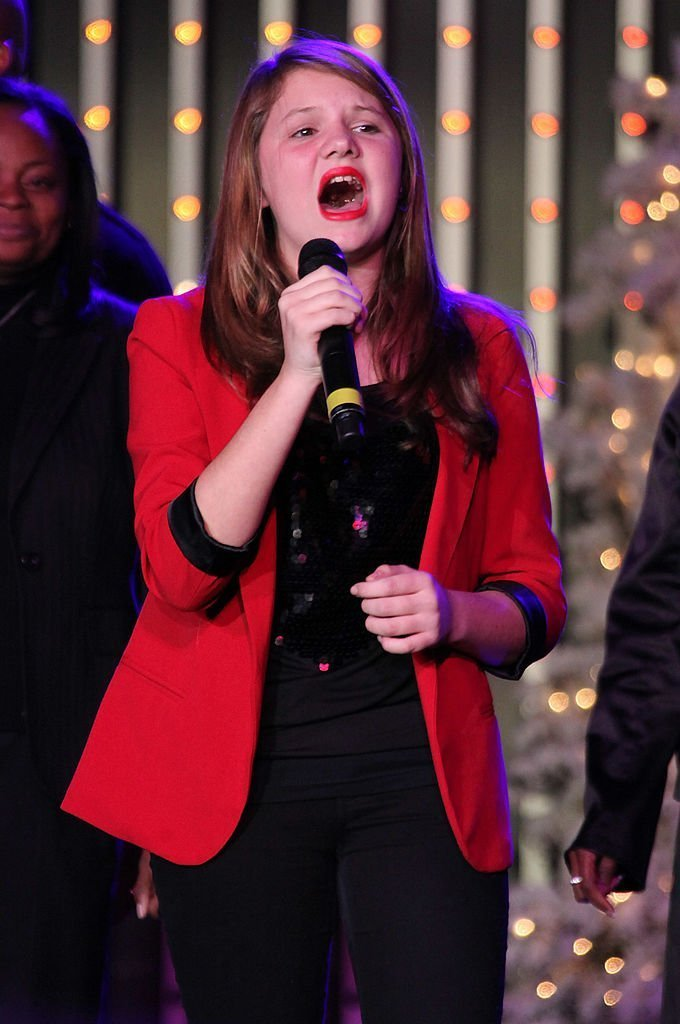 Singer Savannah Robinson performs on stage at the CityWalk Christmas Tree Lighting Ceremony | Getty Images