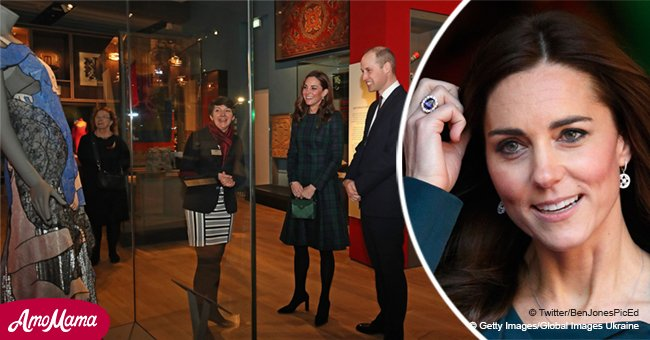 Kate Middleton appears a little red-faced while looking at a racy dress with naked lovers on it