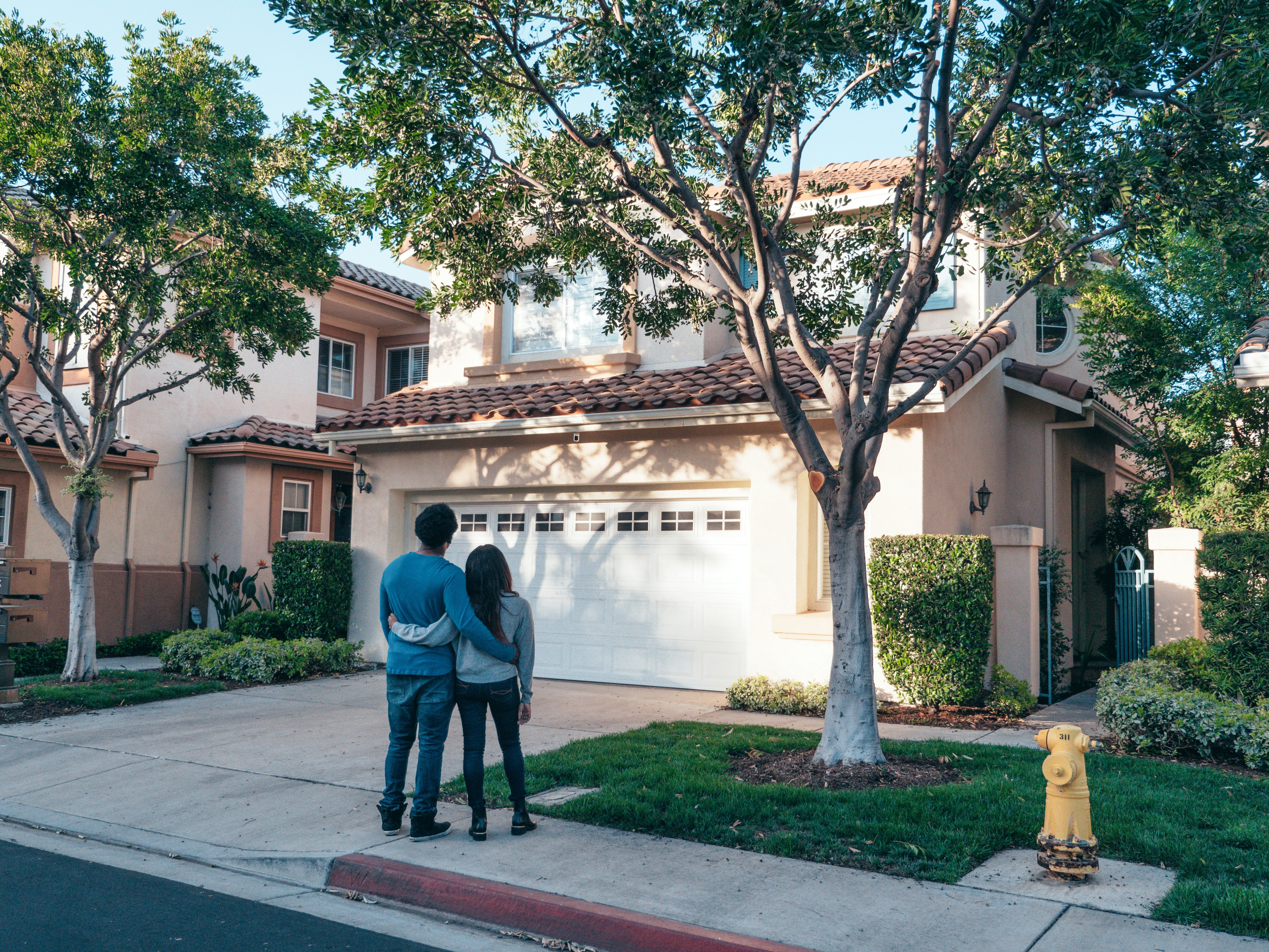 Pictured - A couple standing in front of their house | Source: Pexels