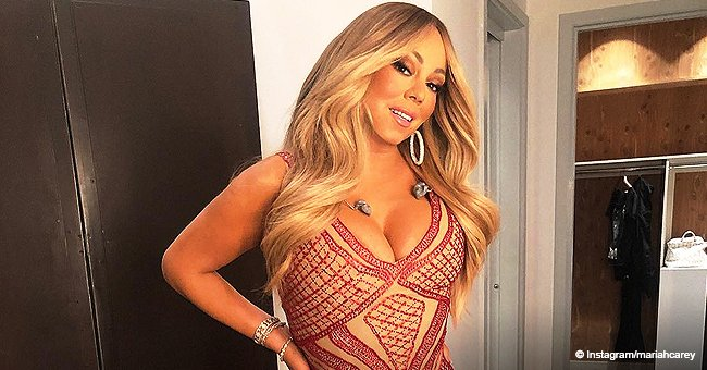 Mariah Carey Flaunts Her Curves in Skin-Tight Red & Nude Mermaid Dress in Recent Photo