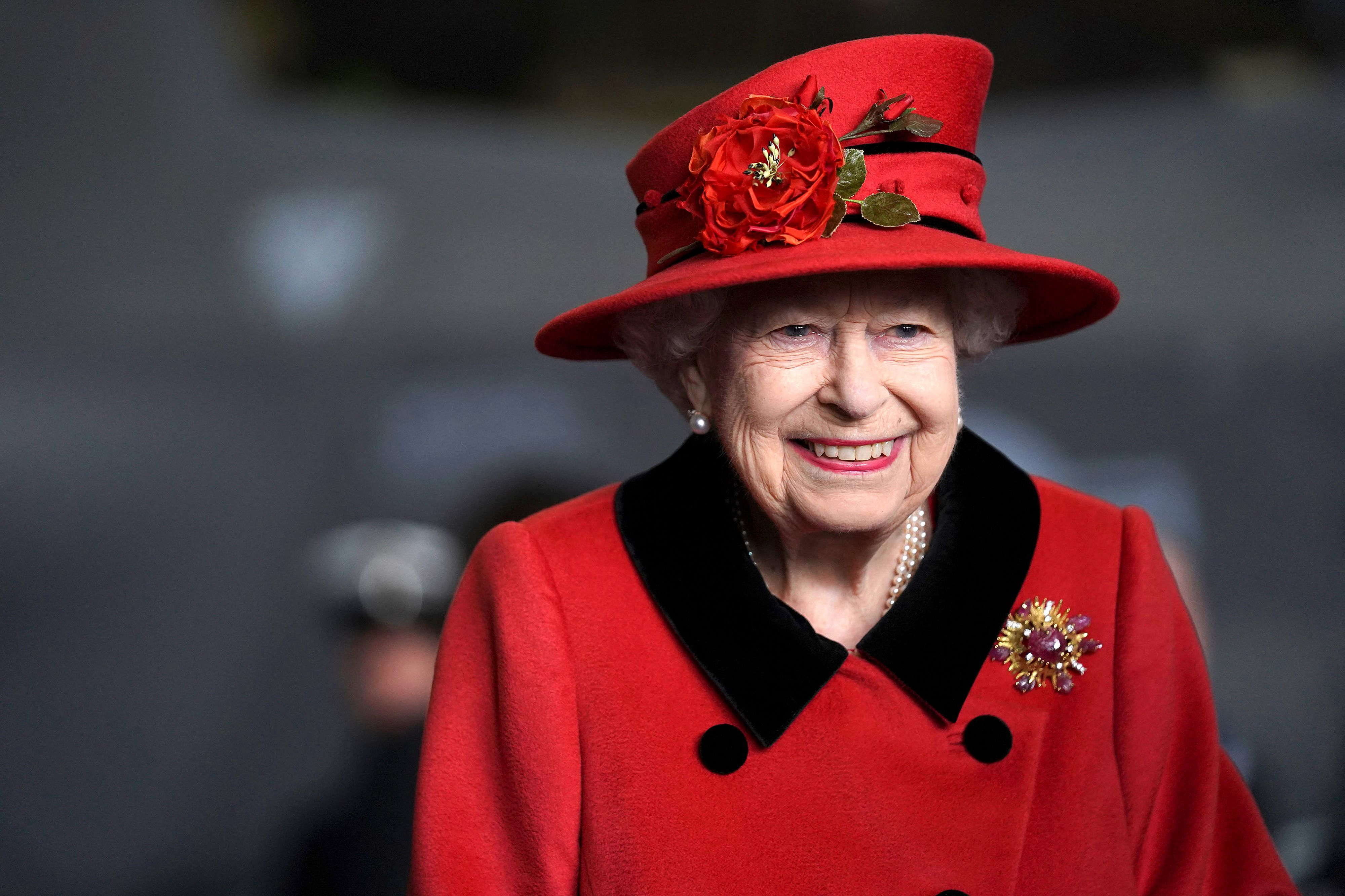 Queen Elizabeth II reacts during her visit to the aircraft carrier HMS Queen Elizabeth in Portsmouth, southern England on May 22, 2021 | Getty Images