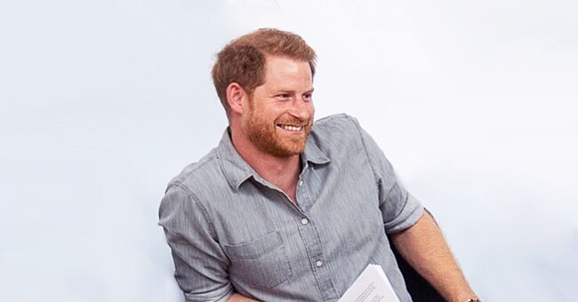 El príncipe Harry reaccionó con una sonrisa a la llamada de Skype de Meghan Markle desde Sudáfrica