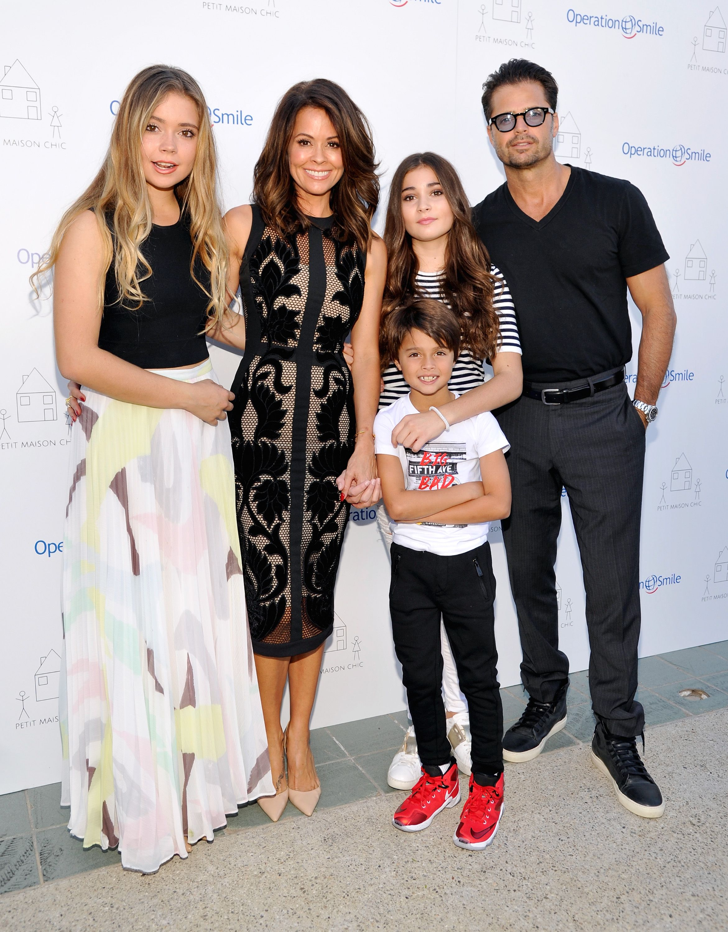 Neriah Fisher, actress Brooke Burke-Charvet, Shaya Charvet, Sierra Fisher and actor David Charvet at the Petit Maison Chic fashion show honoring Operation Smile on November 21, 2015 | Photo: Getty Images