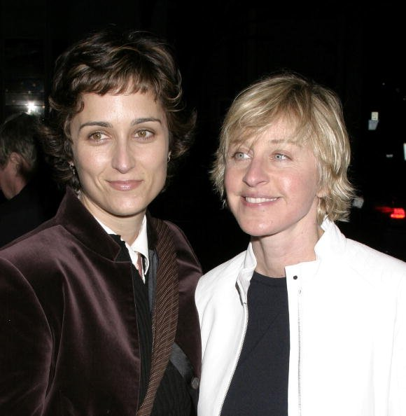 "Ellen DeGeneres (R) and Alexandra Hedison attend the Opening Night Performance of ""Afterbirth: Kathy and Mo's Greatest Hits"", February 27, 2004, at Canon Theater in Beverly Hills, California. 