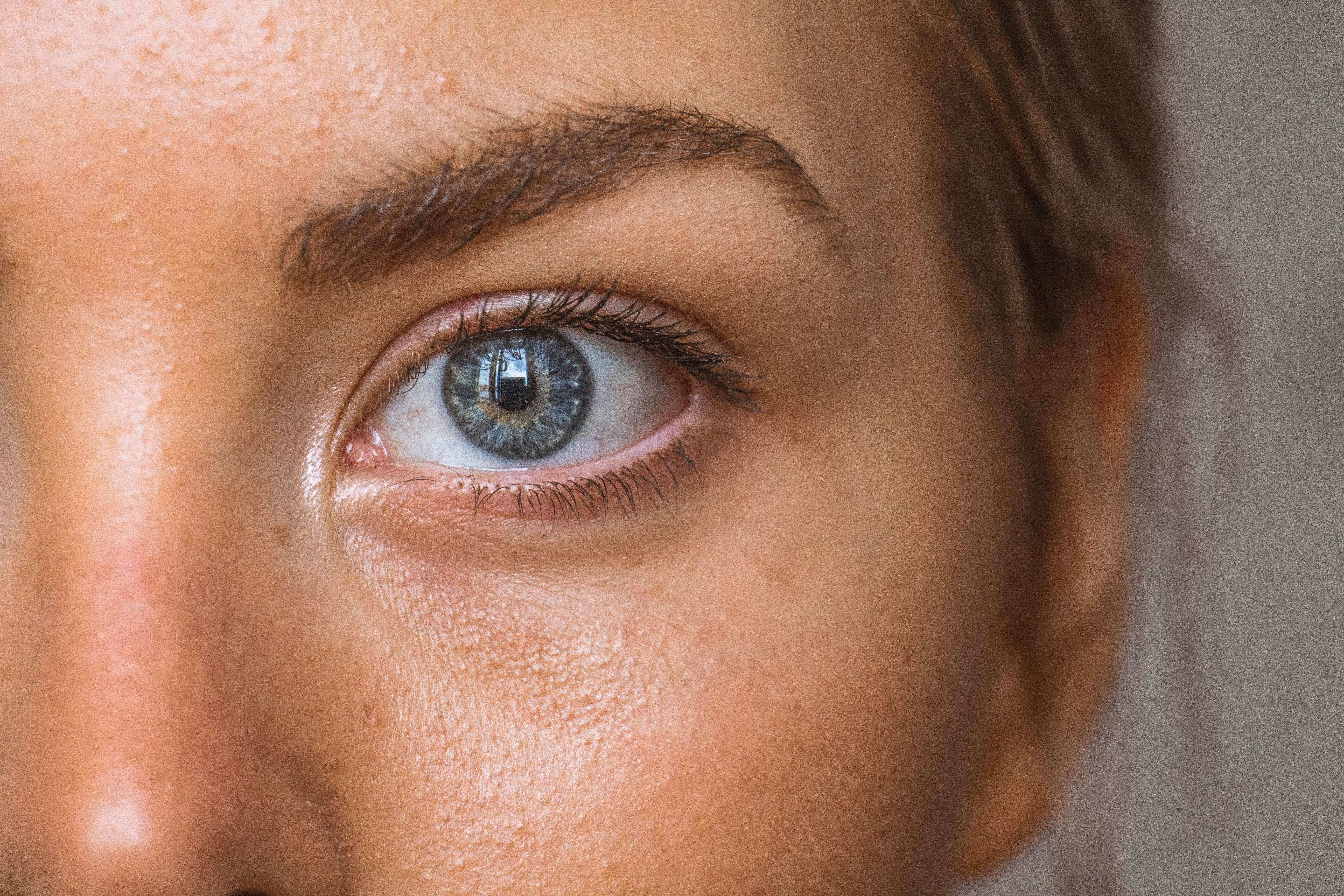 Woman with blue eyes and clear skin   Unsplash