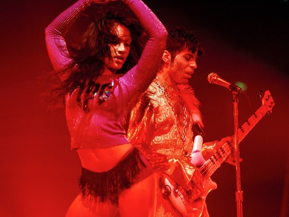 Prince and Mayte Garcia performing on stage at Wembley Arena in London, circa March 1995 | Photo: Getty Images