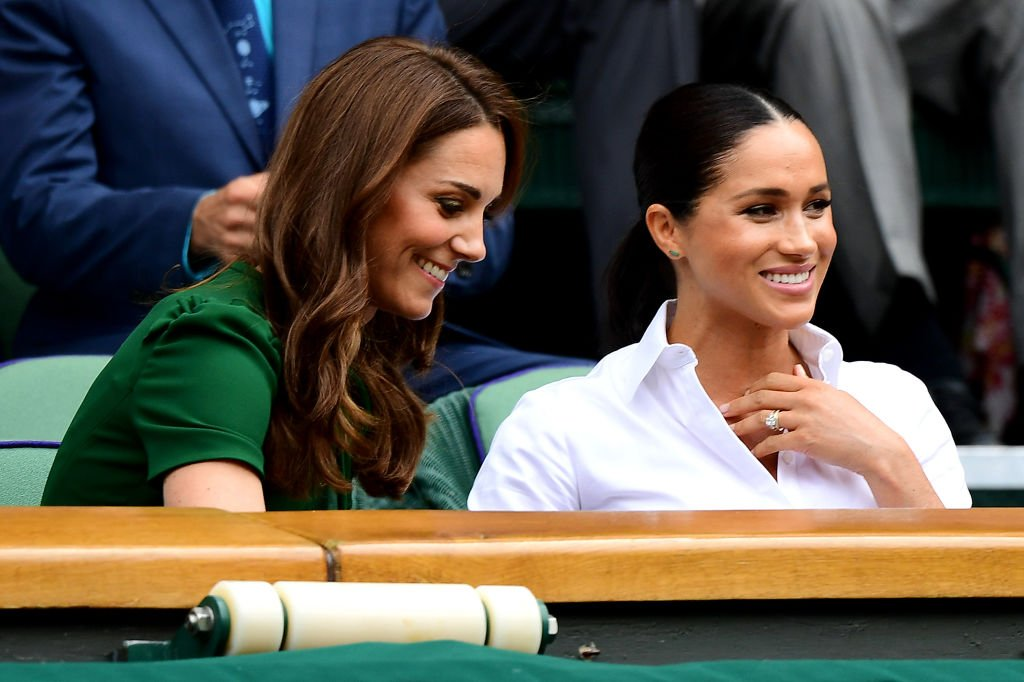 Kate Middleton and Meghan Markle at  the Royal Box during Day twelve of The Championships - Wimbledon, July 2019   Source: Getty Images