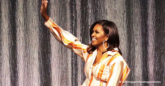 Michelle Obama Dons a Brightly Striped Pant Suit during an Interview in Paris