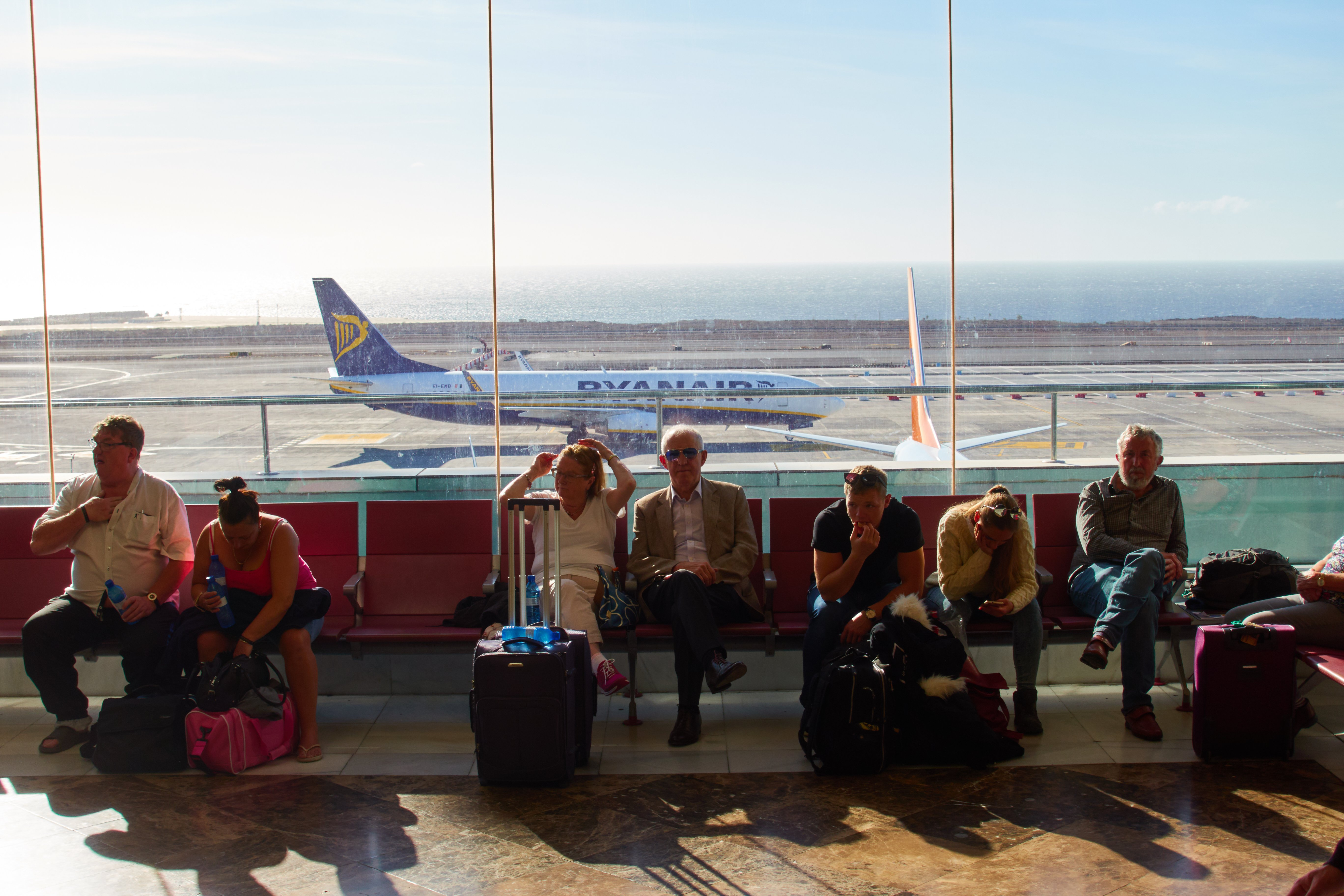 Tourists at the Reina Sofia Airport Tenerife, in Spain | Photo: Getty Images