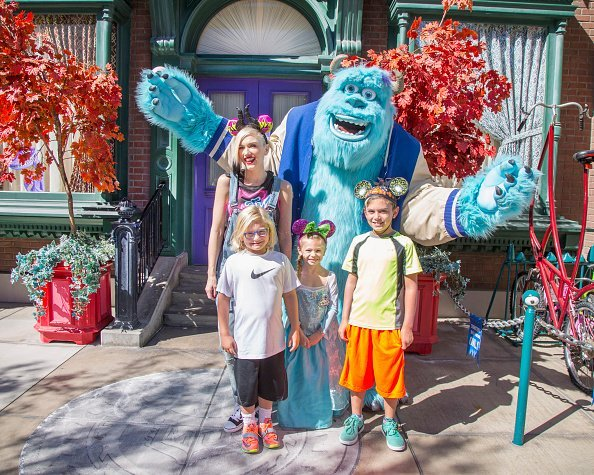 Gwen Stefani and her sons, Kingston Rossdale (right) and Zuma Rossdale, and niece, Stella, meet Sulley from the Disney-Pixar films 'Monsters, Inc.' and 'Monsters University' at Disney California Adventure park October 6, 2014, in Anaheim, California. | Source: Getty Images.
