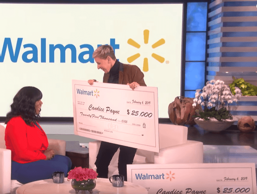 Screenshot of DeGeneres presenting Payne with her cash gifts. | Photo: YouTube/TheEllenShow