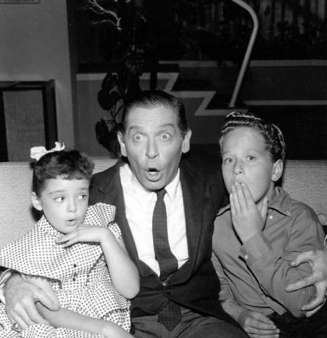 "Milton Berle with Angela Cartwright and Rusty Hamer in ""Make Room for Daddy,"" in 1957. 