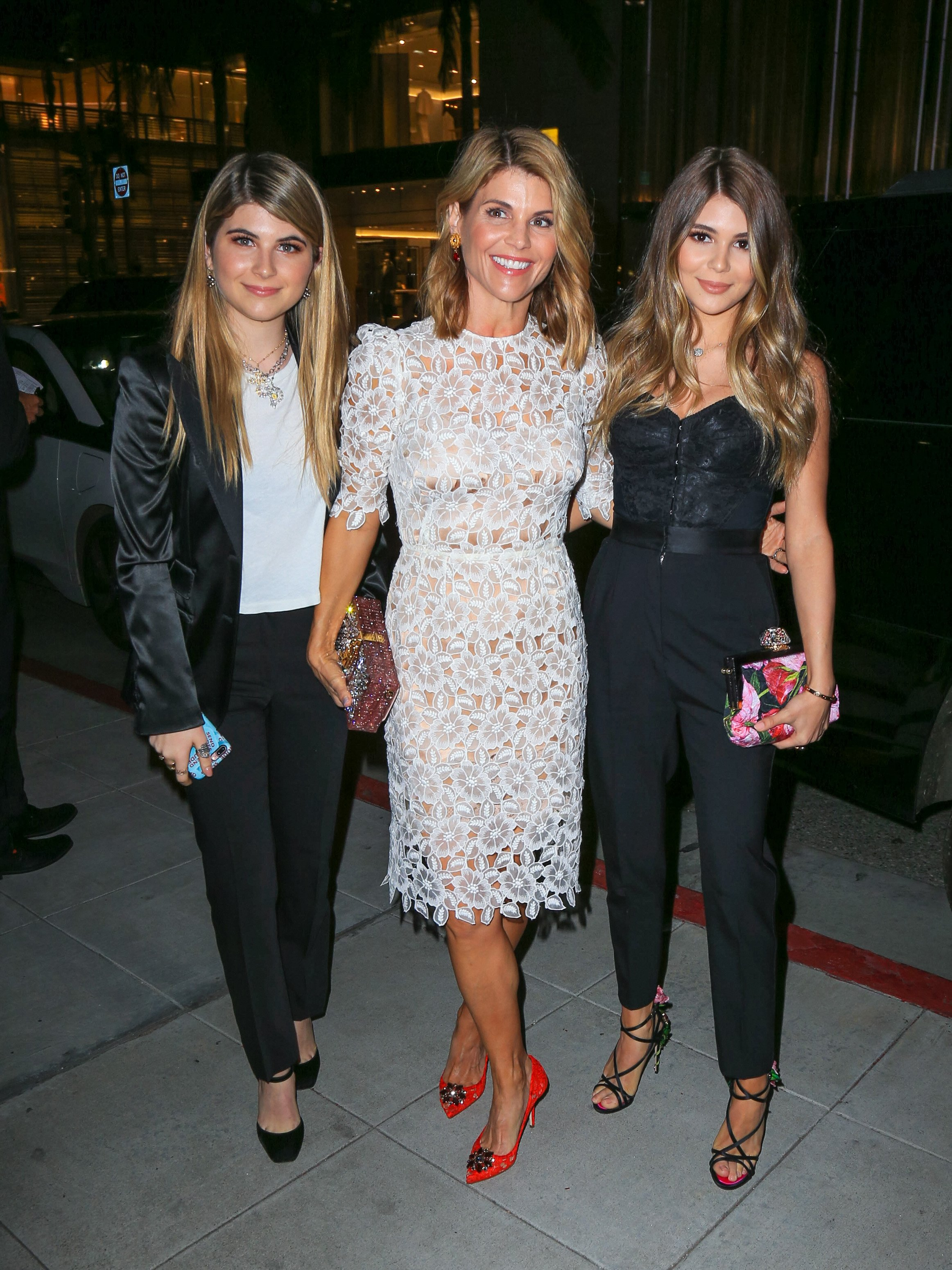 Lori Loughlin and daughter Isabella and Olivia Giannulli pose in Los Angeles, California on March 23, 2017   Photo: Getty Images