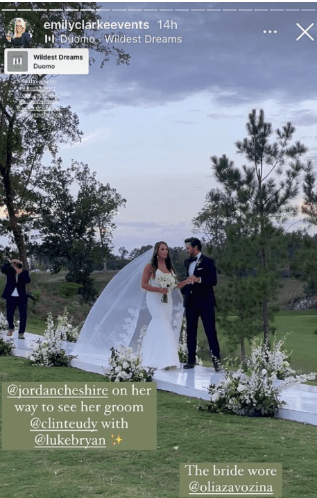 A screengrab from Jordan Cheshire and Clint Eudy's wedding planner Emily Clarke showing the bride and her uncle Luke Bryan walking down the aisle | Source: Instagram/@emilyclarkeevents