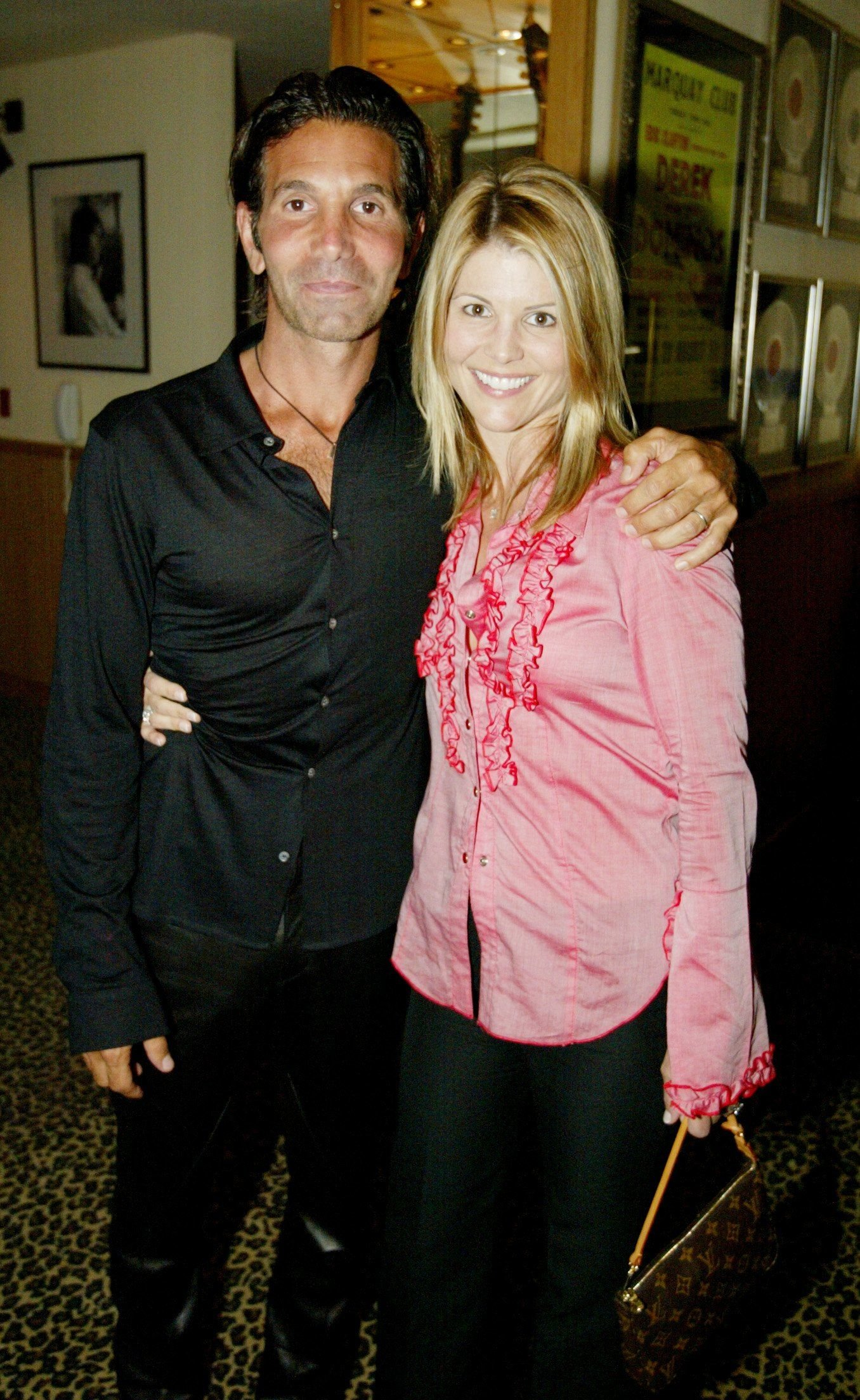 Actress Lori Laughlin and her husband Mossimo Giannulli at an Oasis concert at The Joint inside the Hard Rock Hotel & Casino April 26, 2002 | Photo: Getty Images
