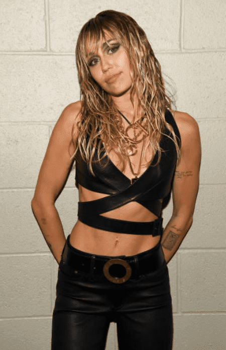 Miley Cyrus poses backstage before her performance at the iHeartRadio Music Festival, on September 21, 2019, in Las Vegas, Nevada | Source: Kevin Mazur/Getty Images for iHeartMedia