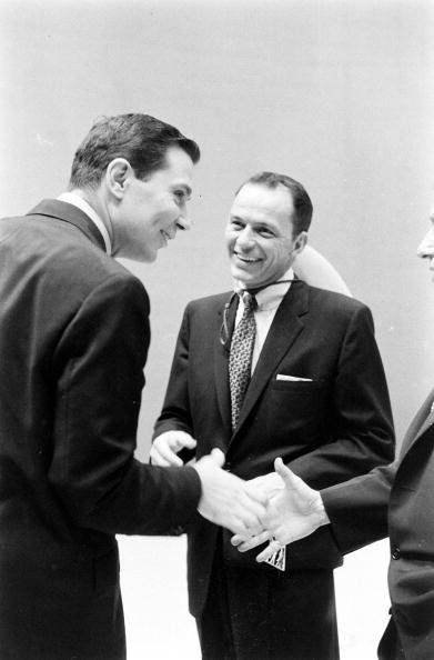 Frank Sinatra  laughs with television announcer Gene Rayburn backstage during the filming of an episode of the television variety program 'The Steve Allen Show,' New York, New York, August 19, 1956 | Photo: Getty Images