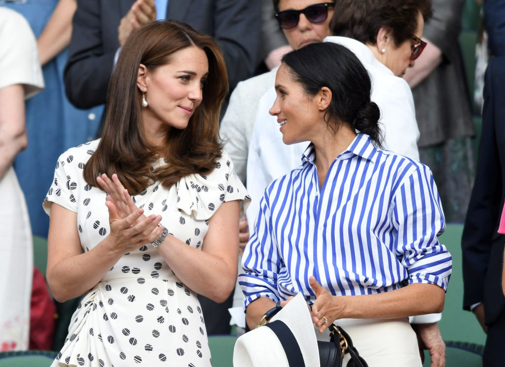 Catherine, Duchess of Cambridge and Meghan, Duchess of Sussex attend day twelve of the Wimbledon Tennis Championships at the All England Lawn Tennis and Croquet Club on July 14, 2018. | Photo: Getty Images