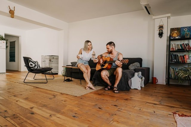 Couple sitting in  Airbnb in Mallorca | Source: Unsplash