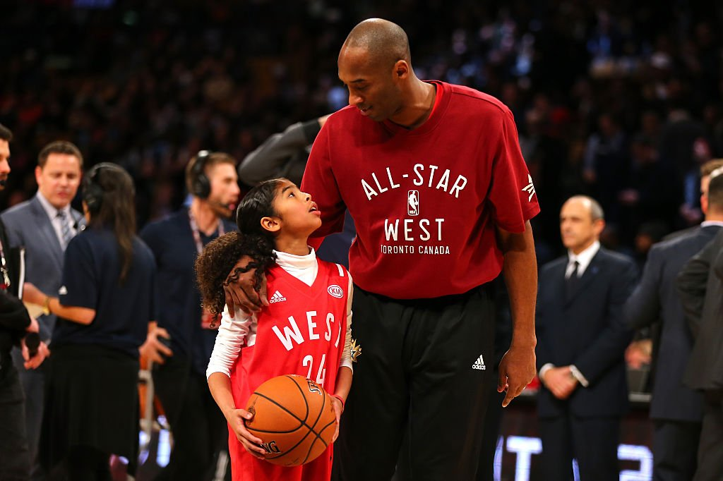 Kobe Bryant of the Los Angeles Lakers and the Western Conference warms up with daughter Gianna Bryant during the NBA All-Star Game 2016 at the Air Canada Centre on February 14, 2016 | Photo: Getty Images