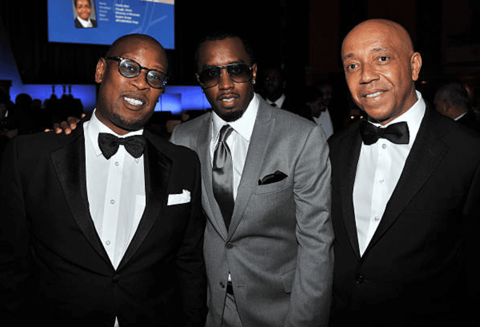 """Andre Harrell, Sean """"P.Diddy"""" Combs and Russell Simmons pose together atthe 2011 Jackie Robinson Foundation awards on March 7, 2011, New York 