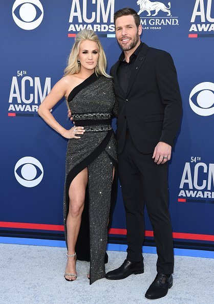 Carrie Underwood and Mike Fisher at the 54th Academy of Country Music Awards on April 07, 2019 | Photo: Getty Images