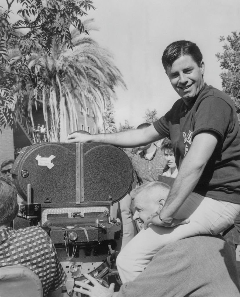 """American actor and comedian Jerry Lewis (1926 - 2017) produces, directs and stars in the film """"The Nutty Professor,"""" being filmed on location at a college campus in Tempe, Arizona, circa 1963.   Photo: Getty Images"""