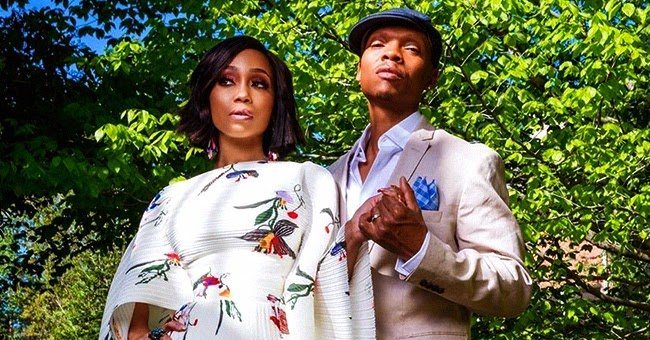 Shamari Fears of RHOA and Husband Ronnie DeVoe Pose in Floral Dress & Tailored Suit in Photo