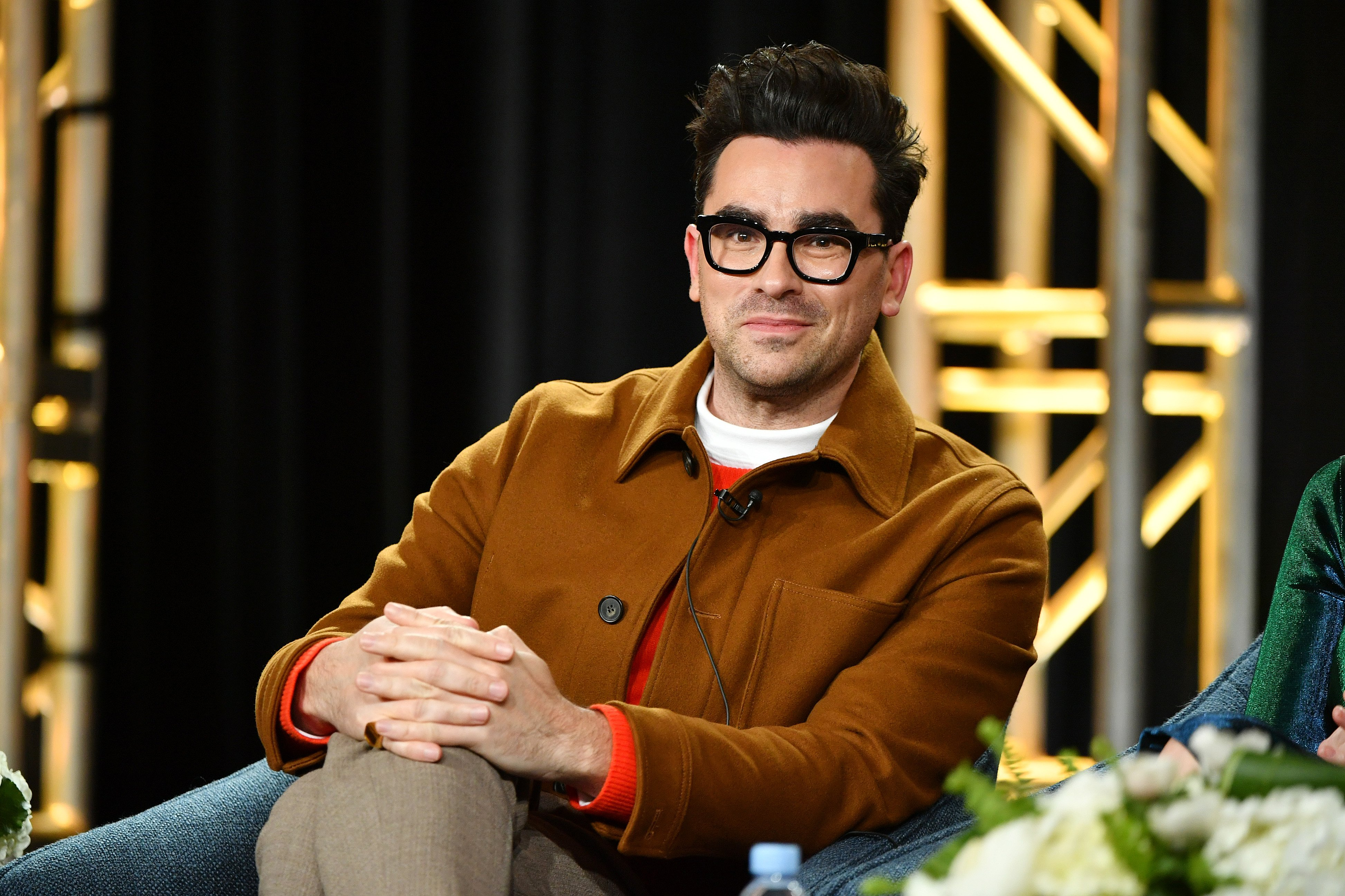 Dan Levy pictured speaking onstage at Pop TV segment of the 2020 Winter TCA Press Tour, 2020, California. | Photo: Getty Images