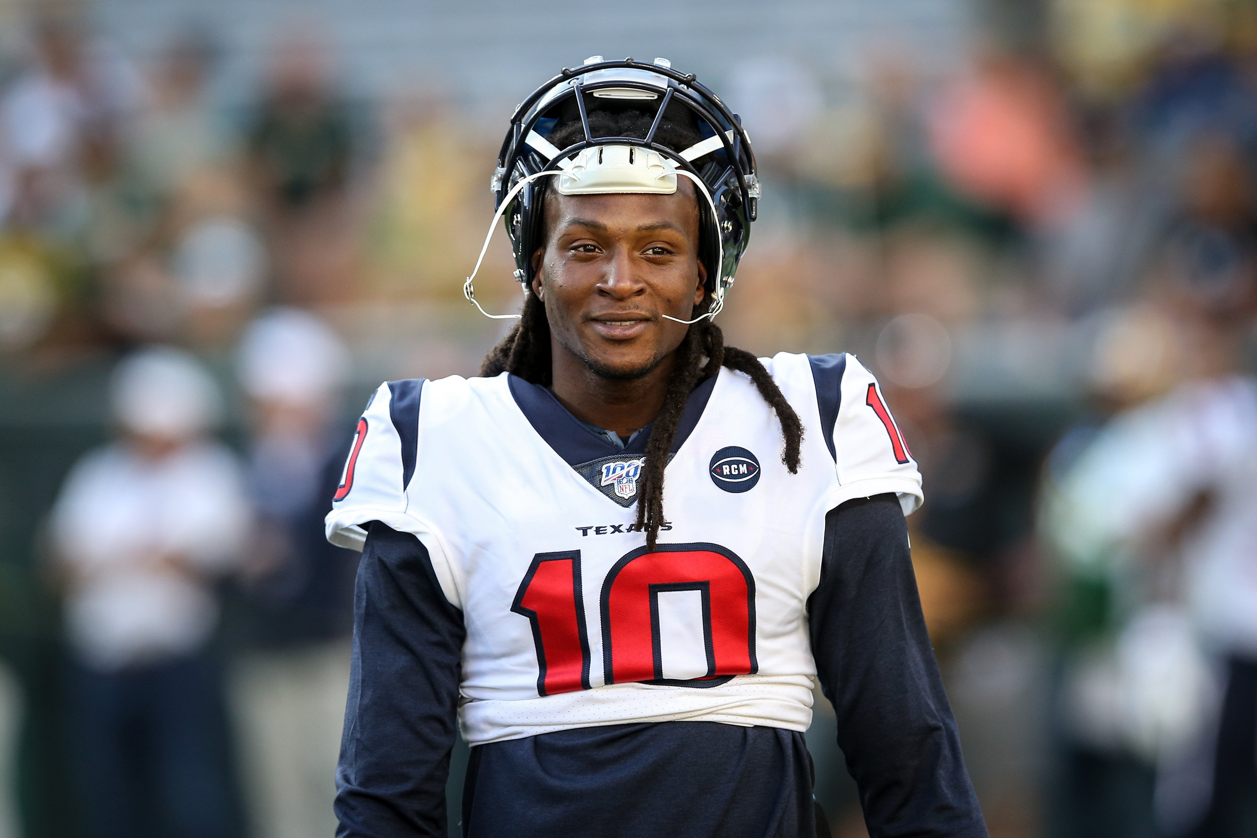DeAndre Hopkins #10 of the Houston Texans looks on before a preseason game against the Green Bay Packers at Lambeau Field on August 08, 2019 | Photo: GettyImages