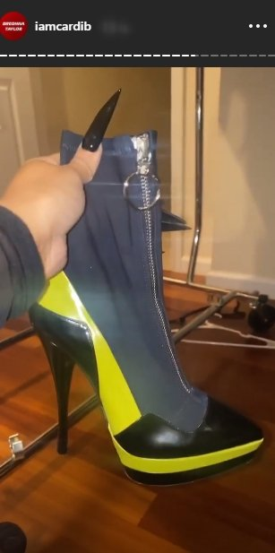 Cardi B flaunting her neon green boots on her Instagram story. | Photo: Instagram/iamcardib