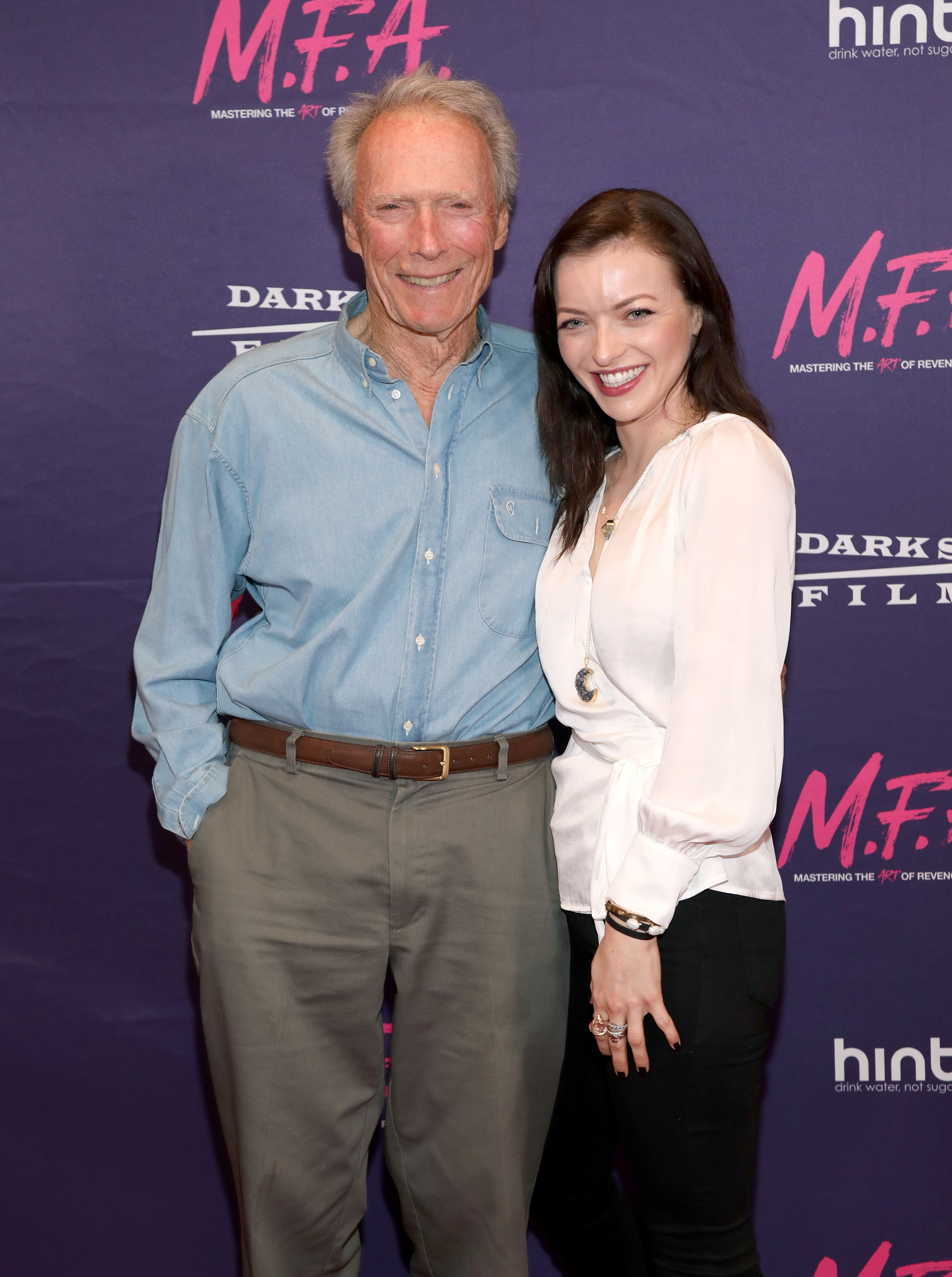 """Clint Eastwood poses with his daughter/actress Francesca Eastwood at the Premiere Of Dark Sky Films' """"M.F.A."""" at The London West Hollywood on October 2, 2017 