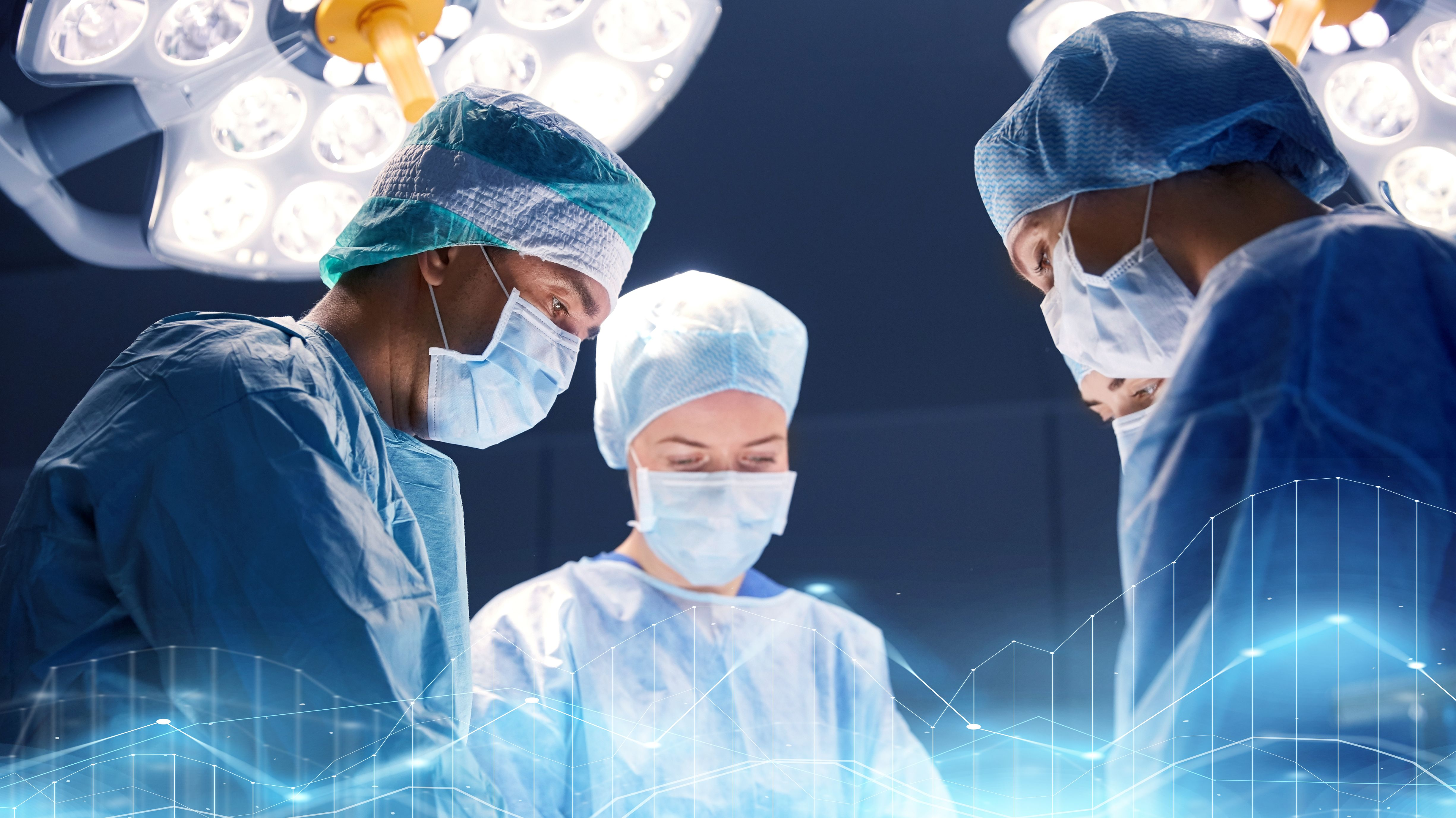Doctors operating on a person. | Source: Shutterstock
