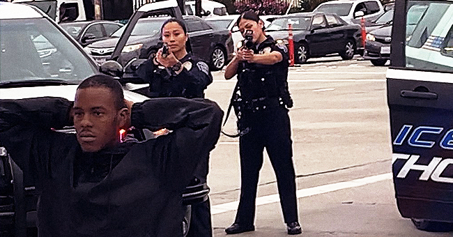Outrage after Video Shows Woman Tearfully Begging Cops Not to Shoot Kneeling 'Unarmed' Man