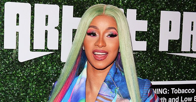 Cardi B Shares Cute Video of Daughter Kulture Wearing a Wide Furry Pink Headband While in a Shopping Cart