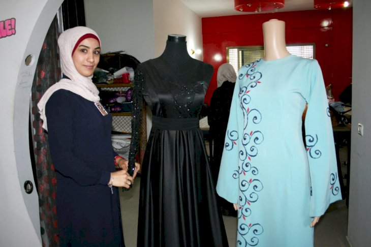 Fashion designer Nermin Demjati in her shop in the centre of Gaza, Palestine, 7 June 2016. The 29-year-old designs individual items for her clients using the brand name 'Voile Moda'. PHOTO: STEFANIE JAERKEL/dpa   usage worldwide (Photo by Stefanie Järkel/picture alliance via Getty Images)