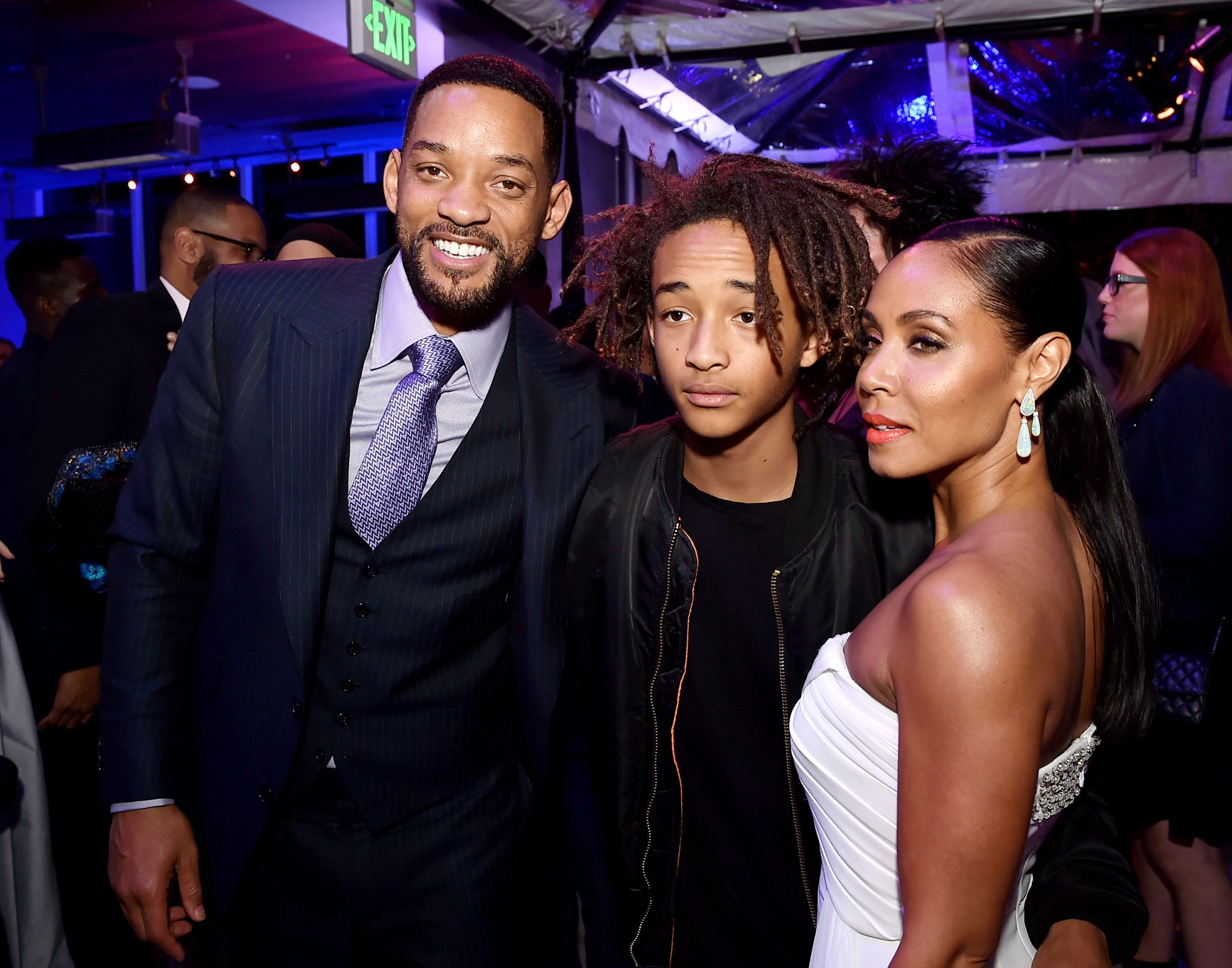 """Will Smith, son Jaden Smith and his wife Jada Pinkett Smith pose at the after party for the premiere of Warner Bros. Pictures' """"Focus."""" 
