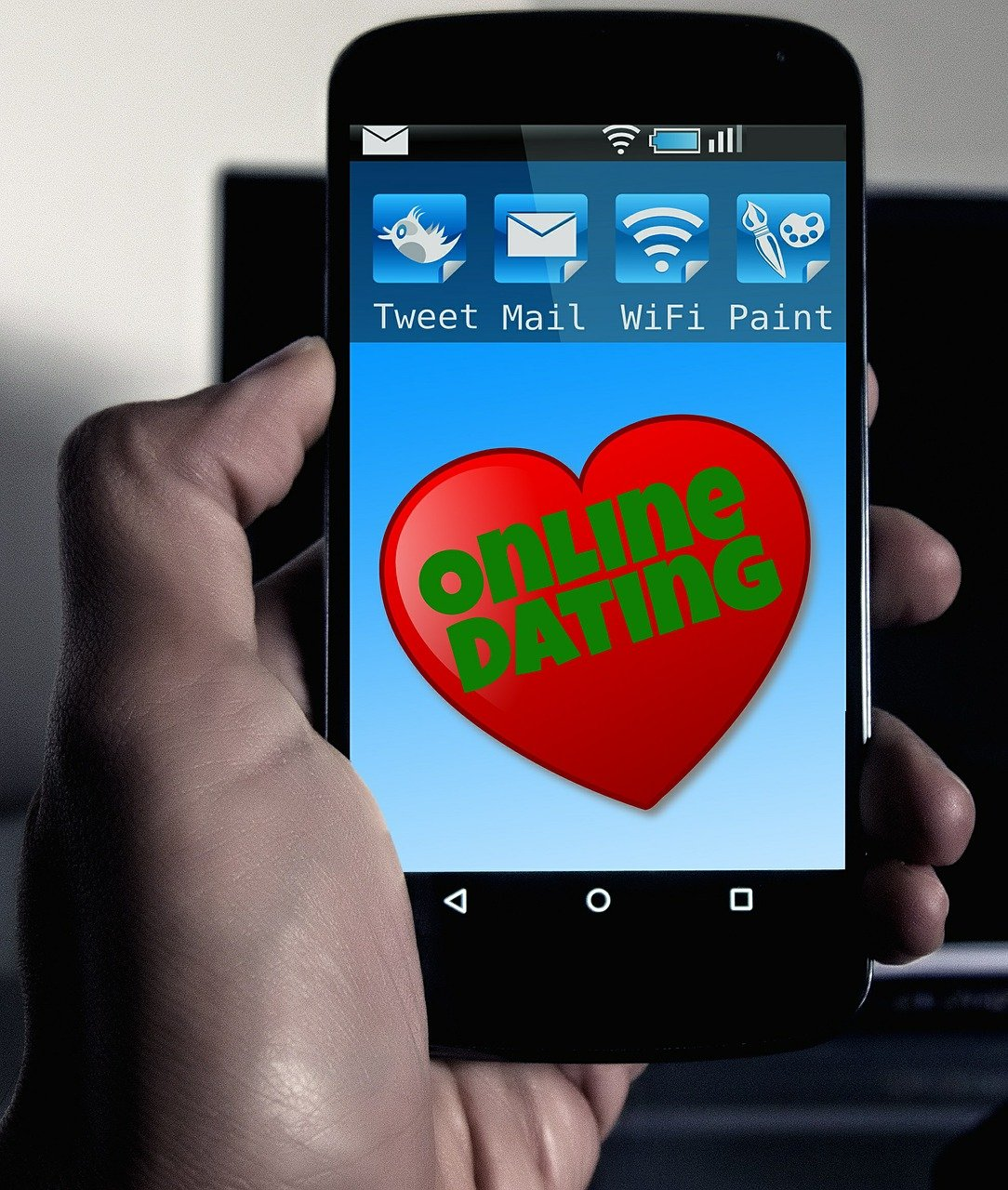A picture of a phone with an online dating app. | Photo: Pixabay