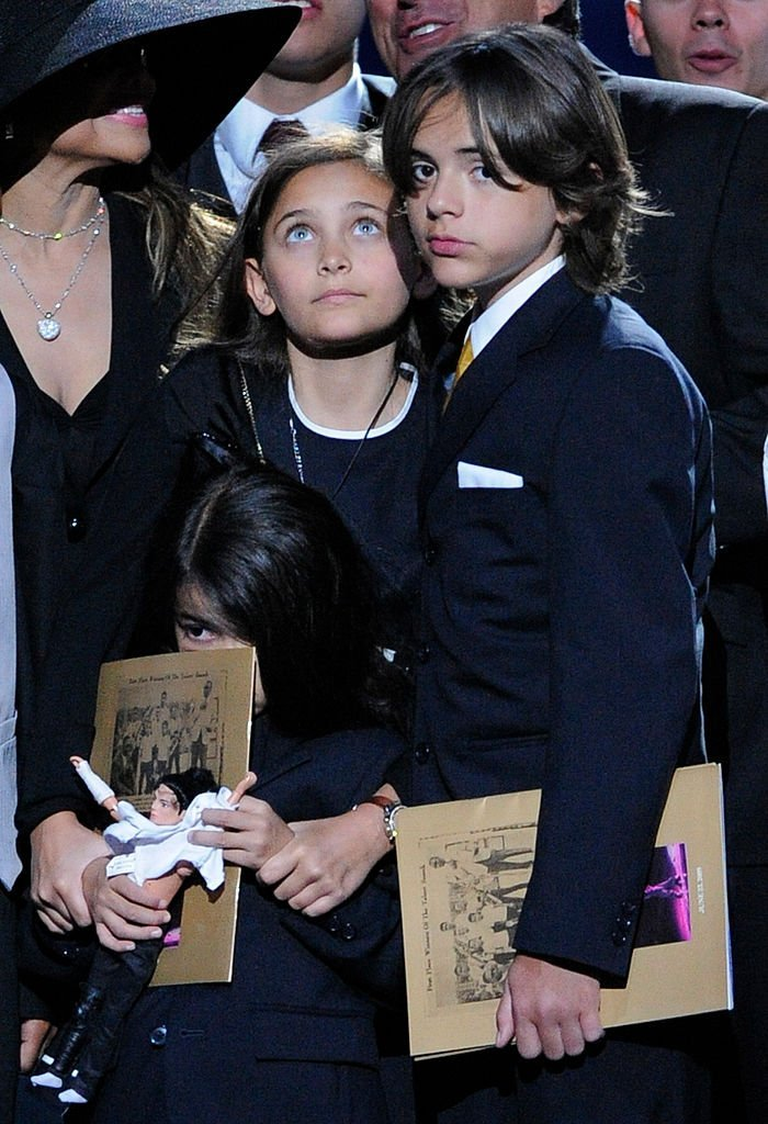 A young Prince Jackson with his siblings Paris and Blanket at the public memorial service for their father, Michael Jackson at the Staples Center on July 7, 2009. | Source: Getty