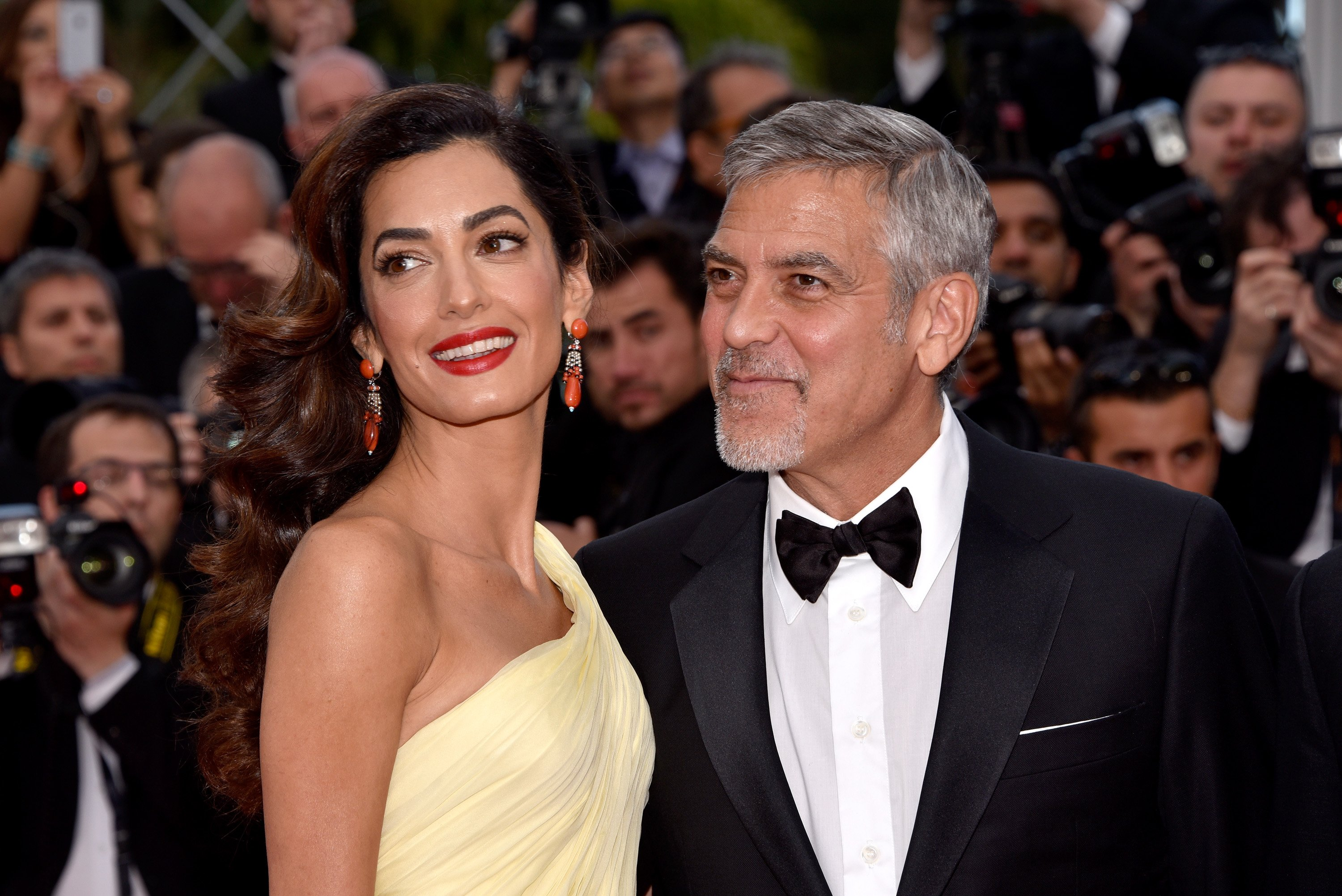 """George Clooney and his wife Amal Clooney attend the """"Money Monster"""" premiere during the 69th annual Cannes Film Festival at the Palais des Festivals on May 12, 2016 in Cannes, France. 
