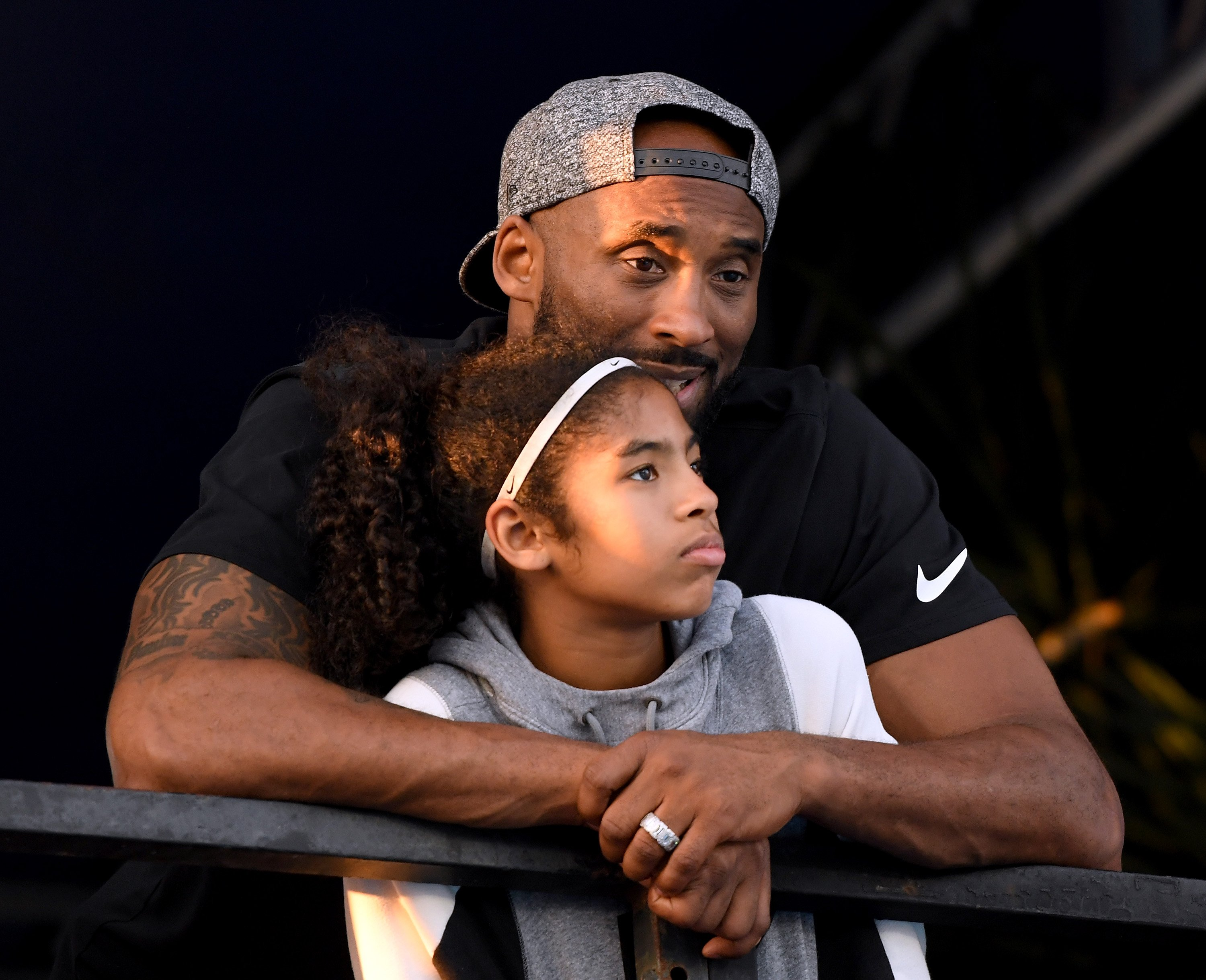 Kobe Bryant and daughter Gianna Bryant watch during day 2 of the Phillips 66 National Swimming Championships. | Photo: GettyImages