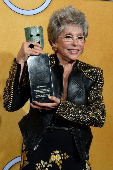 Rita Moreno, recipient of the Screen Actors Guild Life Achievement Award, poses in the press room during the 20th Annual Screen Actors Guild Awards at The Shrine Auditorium on January 18, 2014, in Los Angeles, California. | Source: Getty Images.