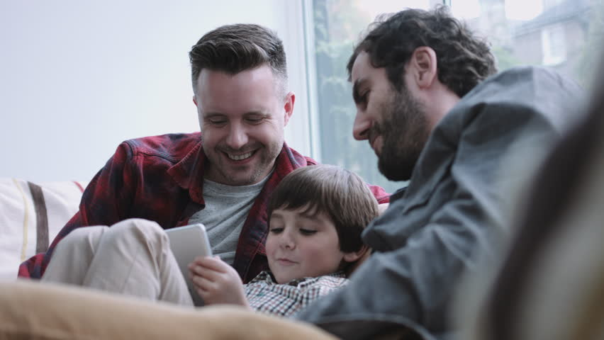 Gay couple having fun with their child | Photo: Shutterstock