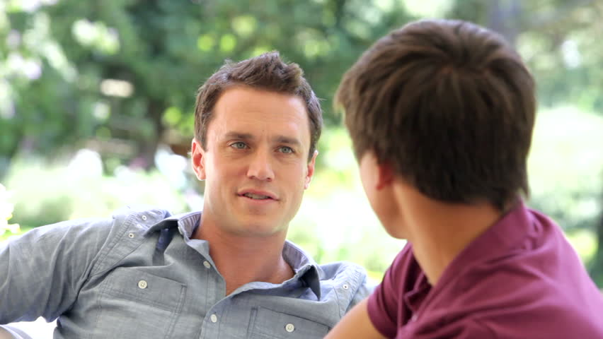 A father talking to his son | Photo: Shutterstock