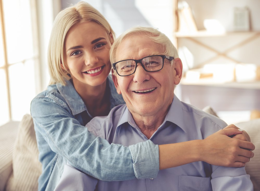 Senior man with young woman | Source: Shutterstock