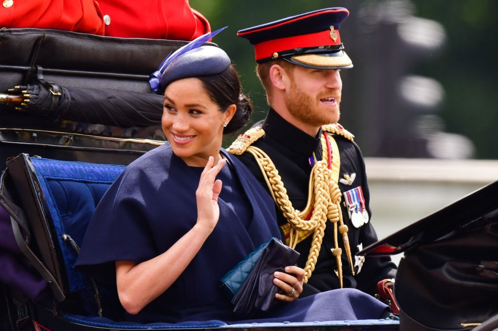 Prince Harry and Meghan Markle in a carriage during Trooping The Colour on June 8 | Photo: Getty Images
