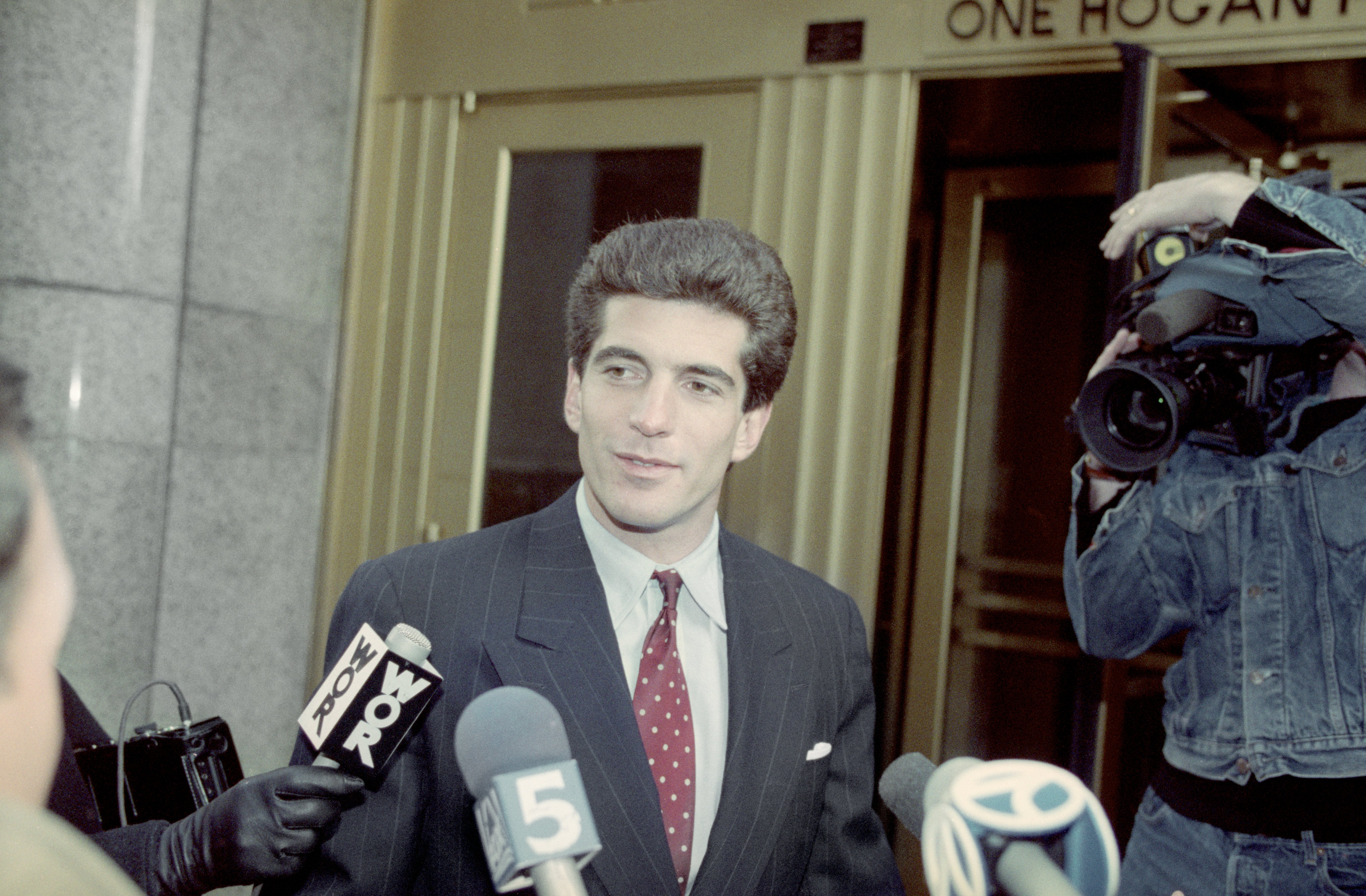 John F. Kennedy Jr. talks to reporters about passing the New York Bar examination | Photo: Getty Images